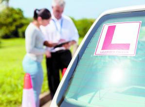 Driving schools happy to get back in the seat